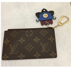LOUIS VUITTON Monogram Totem Key Pouch Flamingo for Sale in Santa Ana, CA