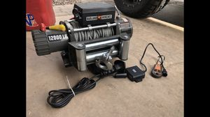 Heavy duty winch with wireless remote quick release bracket mounts for the front or rear vehicle for Sale in Glendale, AZ