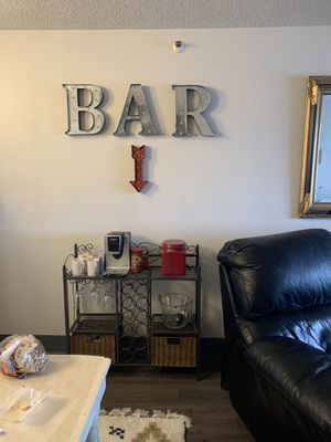 Wine rack & BAR sign. Bought rack in last 6 months. Great condition. for Sale in Tacoma, WA