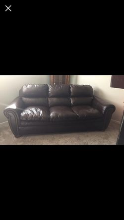 Ashley furniture brown leather couch for Sale in West Point,  UT