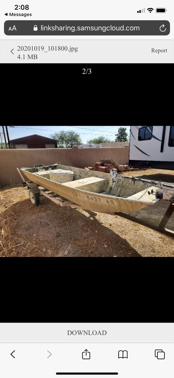 14 foot aluminum boat with a trailer and electric engine