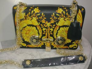 Black and gold designer Versace Crossbody women's evening bag for Sale in Lake Point, UT