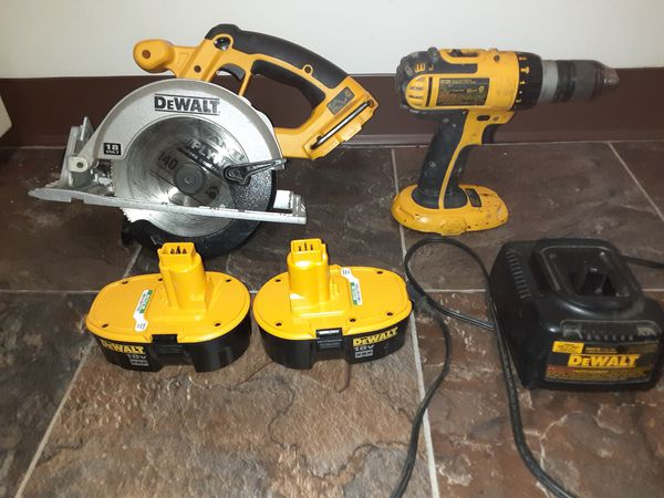 DeWalt battery operated circular saw DeWalt battery operated hammer drill two batteries and a charger