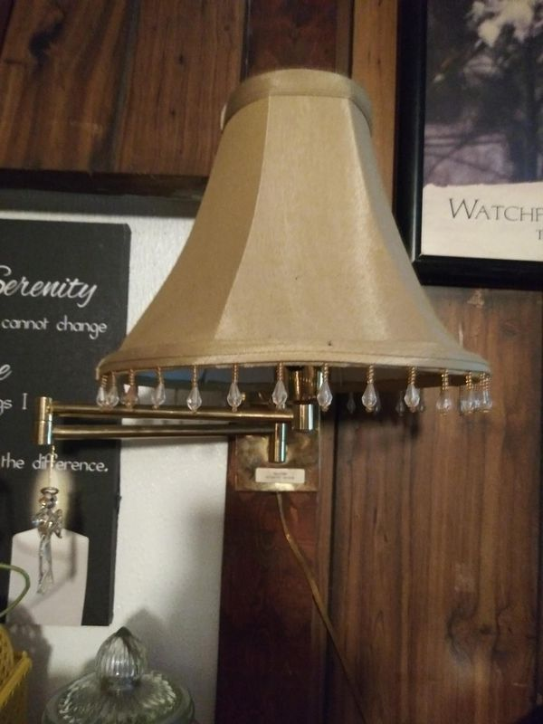 Twin pair of bedside lamps matching including all mounting hardware, shades and bulbs, in excellent condition.