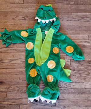 GREEN WITH YELLOW DOTS DINOSAUR INFANT 0/3 MONTHS PRE-OWNED IN GOOD CONDITION WARM PAJAMAS /COSTUME for Sale in Compton, CA