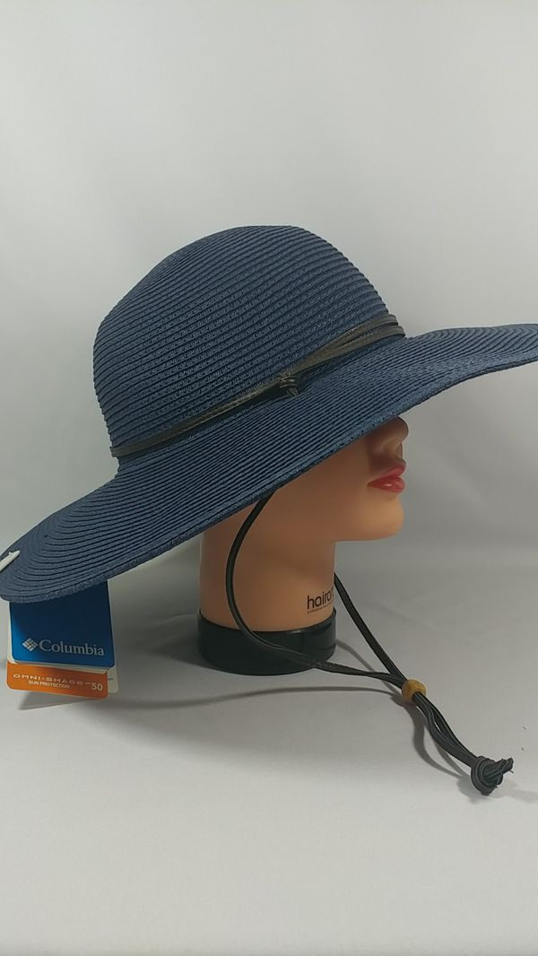 NEW. COLUMBIA WOMENS PACKABLE HAT. BLUE SIZE L/XL