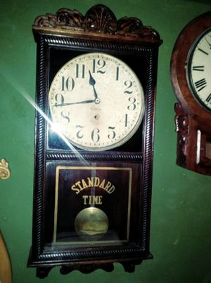 New Haven rail road station clock 38 inches tall .refinished case, all original , time only .dates to 1910 .lists in antique clock books for 700 $. for Sale in Miami Beach, FL
