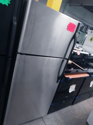 Kenmore stainlees steel top freezer fridge in exelent condition w\4 months warranty for Sale in Baltimore, MD