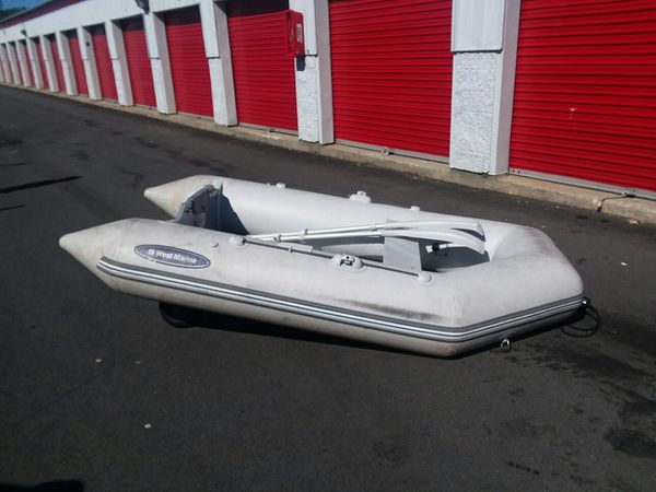 Inflatable boat with wooden bottom and wheels