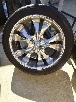 In great condition BZO Big Boss 22 in chrome rims with tires in great condition includes caps for Sale in Chino, CA