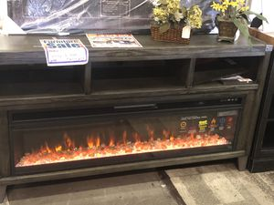 Ashley TV stand $449.95. Fireplace unit available for only $399.95. Brand New. Come on in today! for Sale in Tampa, FL