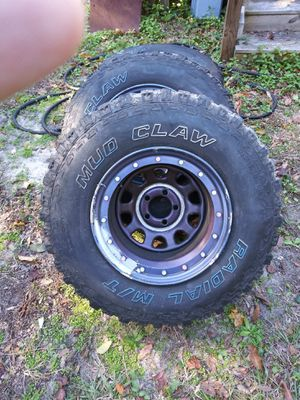 Jeep mammoth deep dish bolt pattern rims and 33' mud claw tires for Sale in Wilmington, NC