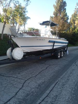23 ft long fishing boat center console Style with to Big outboard motors also including a tandem axle trailer with both clean CA titles for Sale in Norco, CA