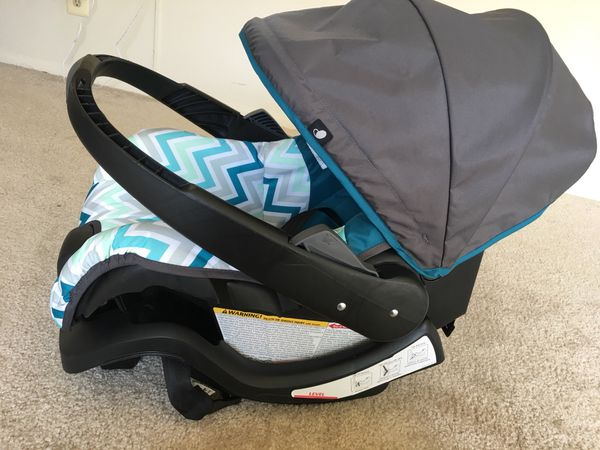 Evenflo brand new car seat with base