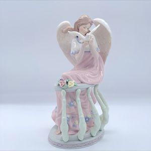 PORCELAIN ANGEL WITH DOVE IN VERANDA. for Sale in Las Vegas, NV