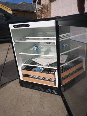 wine cooler in very good condition 34 high by 23 wide by 23 cm side. very clean for Sale in Phoenix, AZ