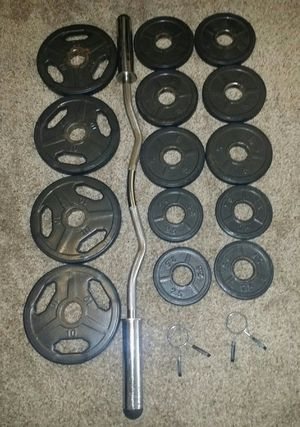 "Olympic 2"" weights with rubber around them. 4x10lbs, 6x5lbs, 4x2.5lbs. Olympic curl bar with 2 weight locks. for Sale in Deerfield Beach, FL"