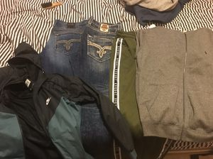 Jeans and jackets for Sale in Dearborn Heights, MI