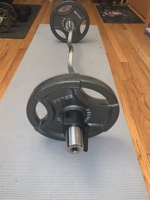 NEW OLYMPIC CURL BAR 47 IN LONG 65 LBS for Sale in Chicago, IL