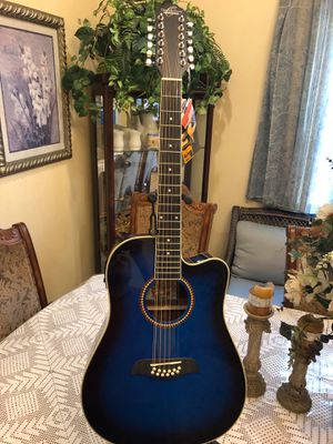 Oscar Schmidt 12 string electric acoustic guitar with built in tuner for Sale in South Gate, CA