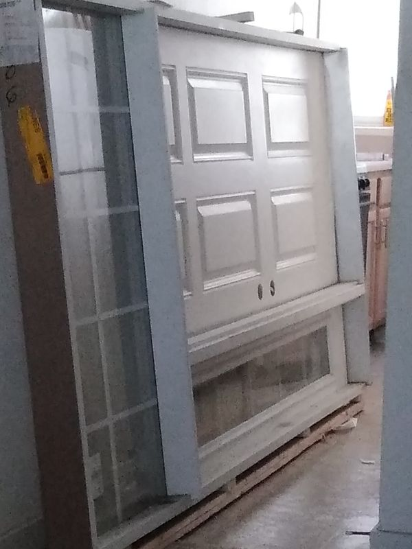 Exterior prehung door with Transit and side windows