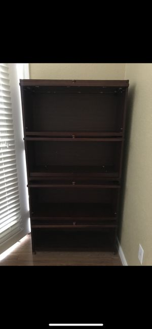 Glass door bookcase for Sale in Houston, TX
