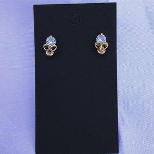 Gold diamond skull earrings for Sale in Anaheim, CA
