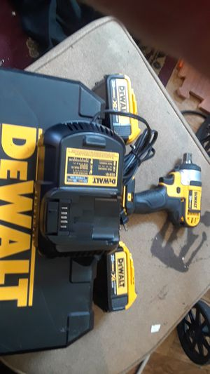 Dewalt impact drill 20 v brushless with w battery case and charger for Sale in Seattle, WA