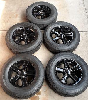 Set of 5 2020 Jeep Wrangler Sahara Black takeoff wheels on Bridgestone. for Sale in Fullerton, CA
