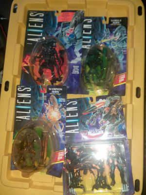 4 different aliens figures in box for Sale in Tarpon Springs, FL
