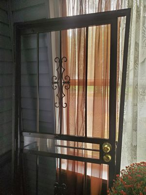 Black security door with screen, 2 keys and extra screws for Sale in Tallmadge, OH
