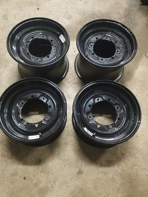 "Polaris RZR 800 Factory Wheels w/valve stems 2ea 12x6 front and 2ea 12x8"" rear 4x156 wheel bolt pattern for Sale in Aurora, OH"