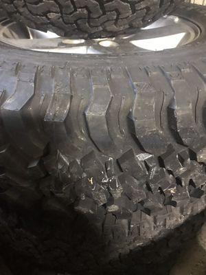2010 Jeep Wrangler factory wheels 17 inch tires have 75%tread left for Sale in Blackstone, VA