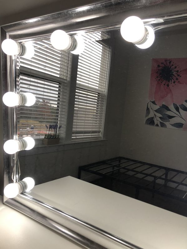 Silver vanity mirror with lights