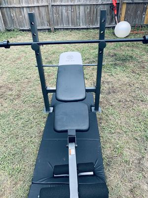 Golds gym bench with olympic barbell for Sale in Brandon, FL