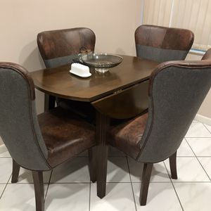 5 Piece Dinette Set Like New Adjustable Duel Sided Drop Leaf Table Dark Brown Wood Vinyl And Cloth Wing Back Chairs for Sale in Altamonte Springs, FL
