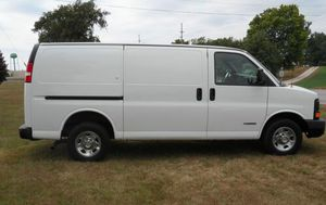 2003 Chevy express 2500 V8 shelves bins for Sale in Kissimmee, FL