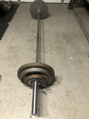Olympic bar with weights for Sale in Riverside, CA