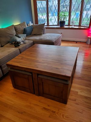 Solid Acacia Wood Table with 4 roll out seats/storage ottomans for Sale in Dearborn Heights, MI