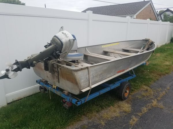 Aluminum 14 ft boat with 10hp Johnson motor and trailer