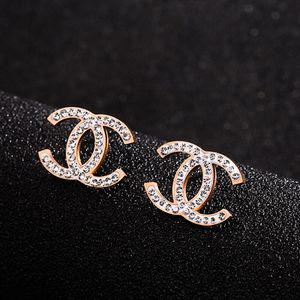 New CC Titanium Rose Gold Plated surrounds diamonds Stud earrings for Sale in Corona, CA