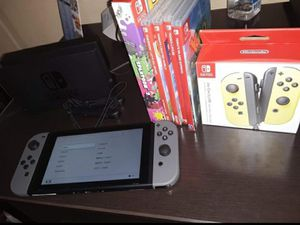 5 game lot & yellow joy-con set with complete gray nintendo switch console pristine condition for Sale in Silver Spring, MD