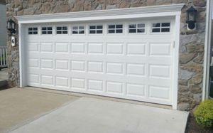 SHORT RAISED PANEL GARAGE DOOR for Sale in Houston, TX