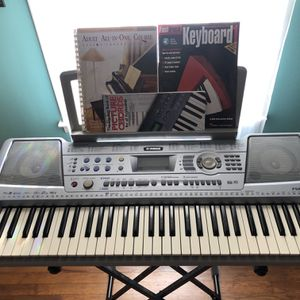 Grey Yamaha PSR-292 With Stand and Learning Books for Sale in Lilburn, GA