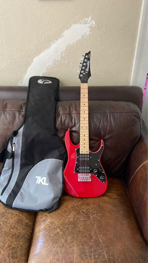 Red and black electric guitar with gig bag( Ibanez) mikro size for Sale in Middletown, CT