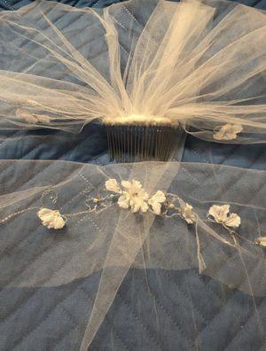 Beautiful wedding veil, a hair piece , an extra petticoat skirt for Sale in Orlando, FL