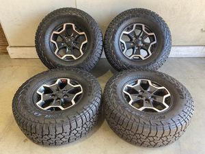 """17 JEEP WRANGLER GLADIATOR RUBICON WHEELS WITH FALKEN WILDPEAK A/T Tires. for Sale in Glendale, CA"