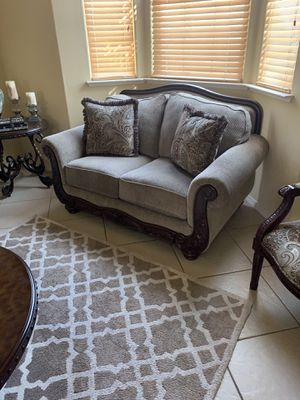 Ashley furniture almost brand new no scratches One big table, one small table, two chairs, two couch cash only or PayPal thank you for Sale in Fresno, CA