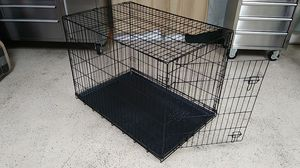 Extra-Large dog kennel. 30 in.high. 42 in long.27 in wide. Black metal. Clean and very good condition. for Sale in Yucca Valley, CA