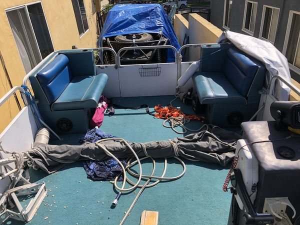 1986 Evinrude 75 pontoon boat and trailer
